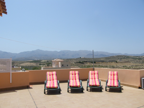 2844.casa_ronda_sunbeds_on_roof_terrace_with_mountains.jpg