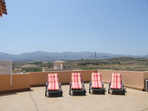 2844.tn-casa_ronda_sunbeds_on_roof_terrace_with_mountains.jpg
